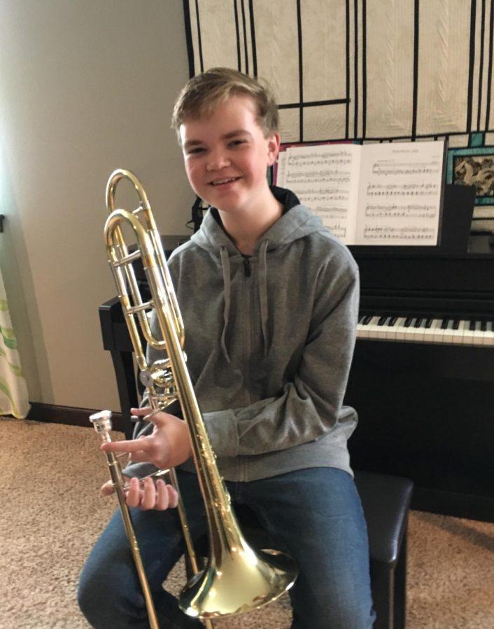 Brody+Schoon%2C+freshman%2C+posing+holding+his+trombone.