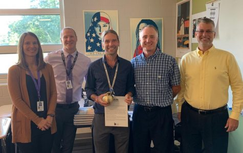 Shutt holding up his golden apple and certificate during the award ceremony on Wednesday, September 25th.