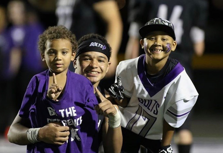 Kaleb poses for a picture with Aidan and his brother. After the 2018 Mid-Prairie game.