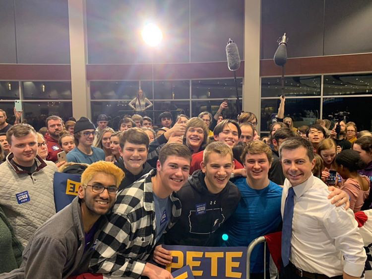 Students who attended the Pete Buttigieg rally on Monday, January 27th gather around presidential candidate Pete Buttigieg.