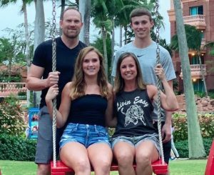 The Woody family, Joey, Isabelle, Heather, and Drake, pose for a family photo in the Bahamas.