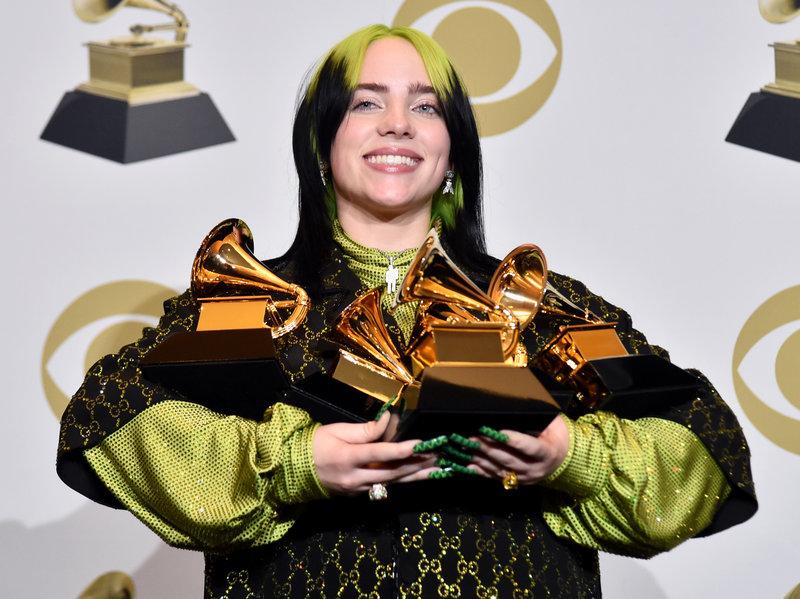 Billie+Eilish%2C+18%2C+pop+singer%2C+holding+her+4+winning+Grammy+awards+from+the+62nd+show.+