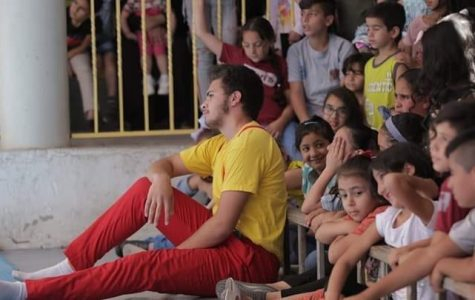 In Palestine, senior Mohammad Awwad performs in the circus as children watch.