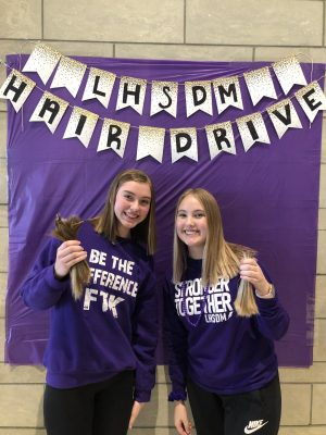 Andrea Belding and Mckenna Schroeder posing for a picture after donating their hair.