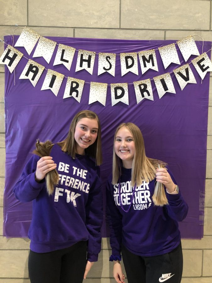 +Andrea+Belding+and+Mckenna+Schroeder+posing+for+a+picture+after+donating+their+hair.+