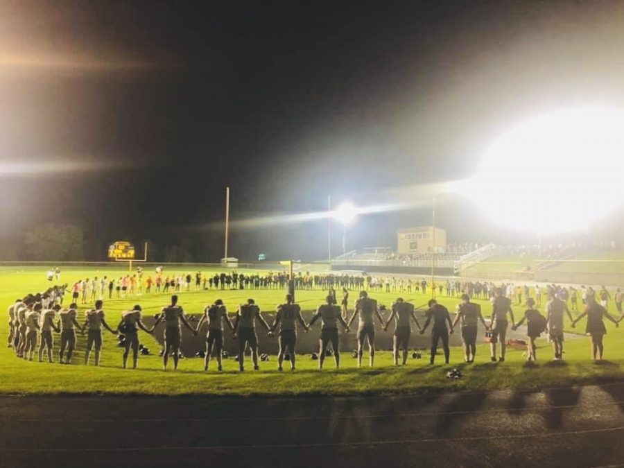A group prayer after the football game vs Mid Prairie on 9-20-19