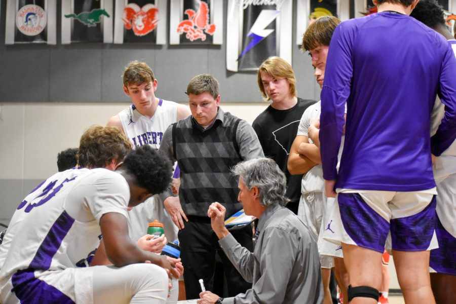 Head Coach Stu Ordman talks to the team during a timeout.