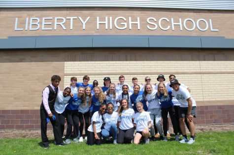 The boys and girls who qualified for the Drake Relays pose for a picture before they leave for the blue oval.