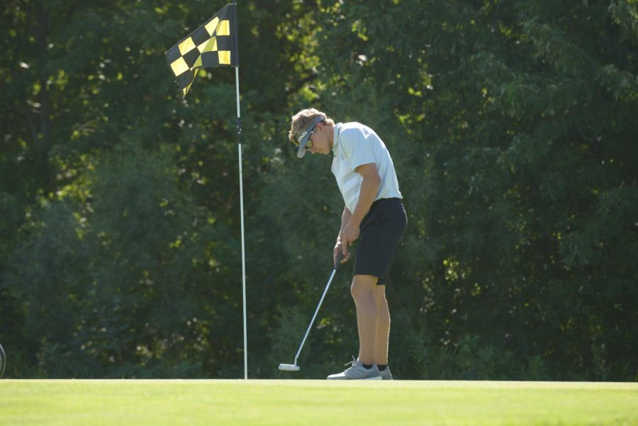 Luke Nichols, senior, takes a putt at hole one at Brown Deer Golf Club