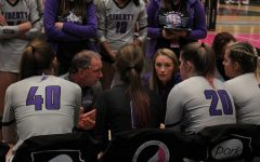 Liberty coaches Randy Dolson and Allie Kelly talk to the team during a time out at the state tournement in 2019.