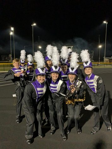 Gabby Brecht and her friends pose for the camera after marching in a 2019 Liberty football game.