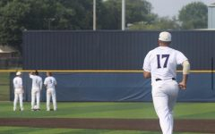 Alec Boldt runs out onto the field before the game.