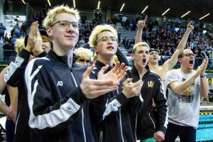 The swim team celebrates during the state meet.