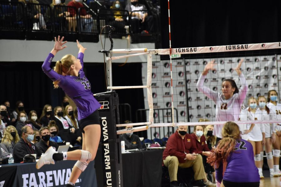 Cassidy Hartman jumps to hit the ball across the net at State.