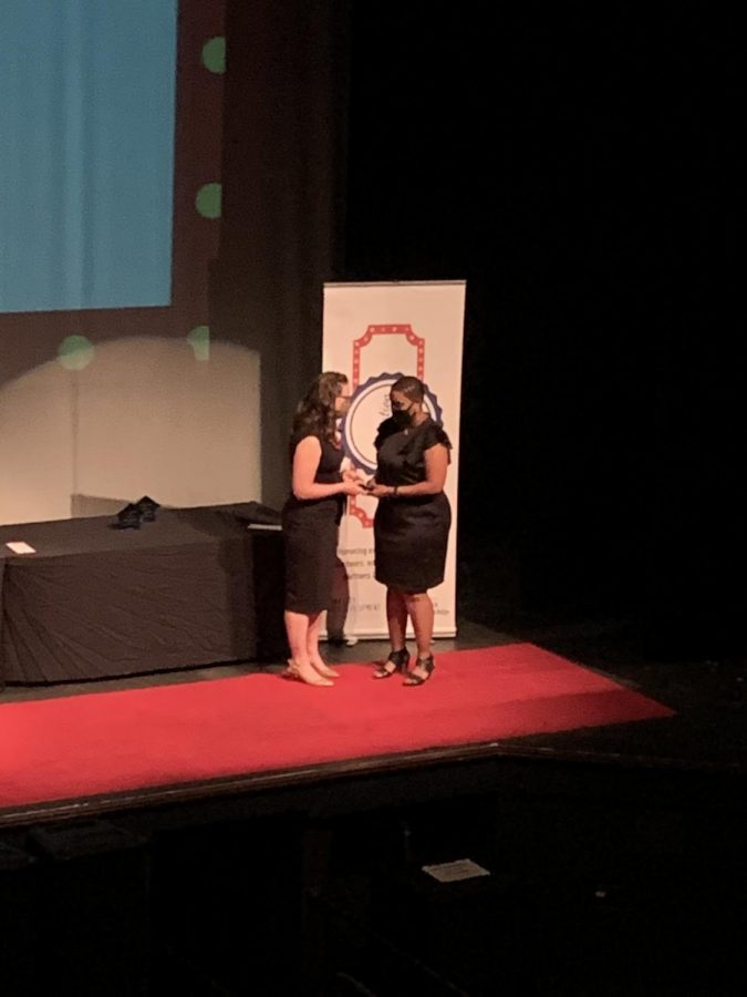 Carmen Gwenigale accepts her Inspire Award at the Innovation in Education Awards.