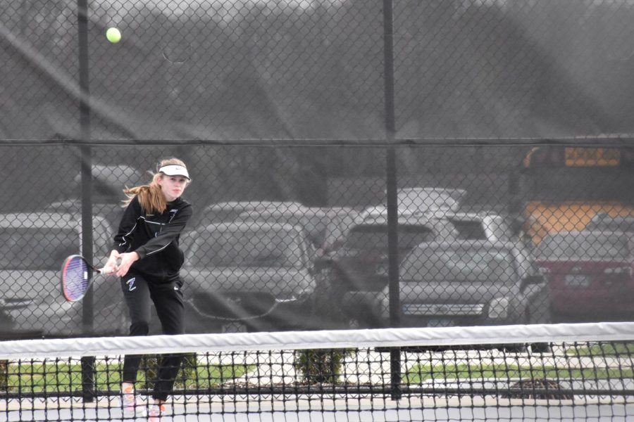 Ella returns the ball to her opponent. She played first position this year.