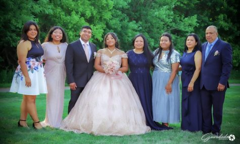 Amy Hernandez, sophomore, center, poses with her family at her Quinceñara. A Quinceñara is a huge celebration for young Hispanic women surrounding their 15th birthday.