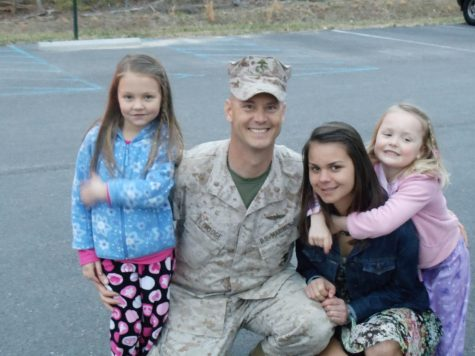Erik Eldridge comes home and is welcomed by his daughters.