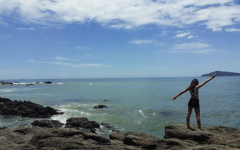 Marina Santos, sophomore, poses outside her grandmas beach house in Balneário Camboriú, Brazil.